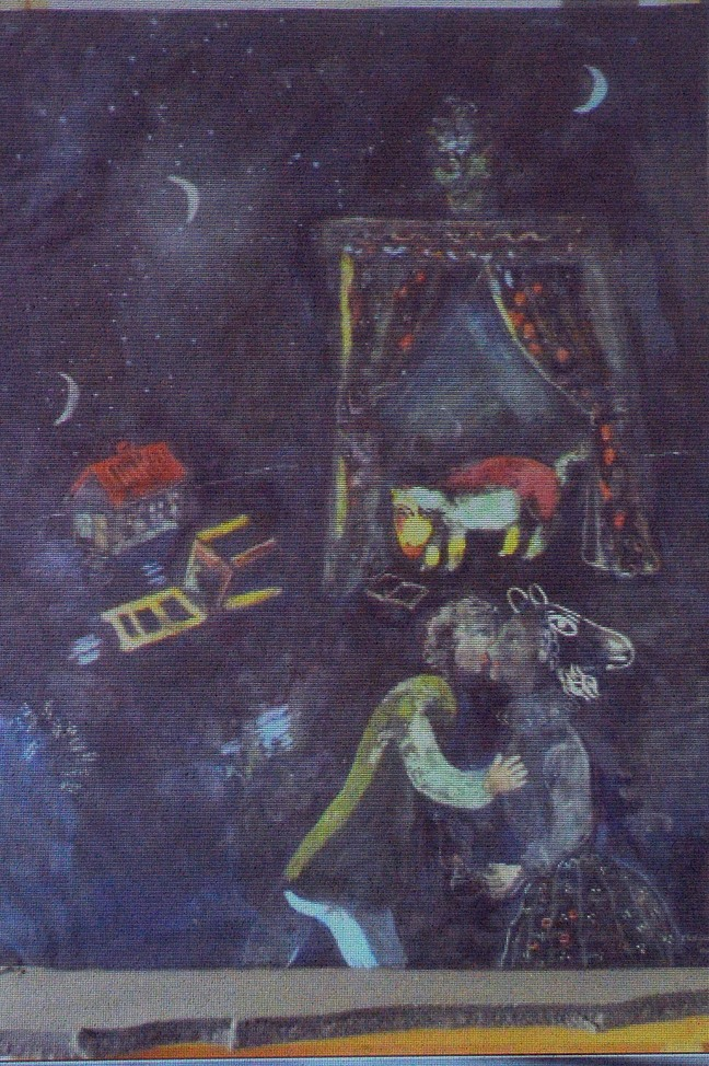 A painting by Marc Chagall is projected on a screen during a news conference in Augsburg, Germany. German investigators say they face a complex task to establish where the more than 1,400 works of art came from.