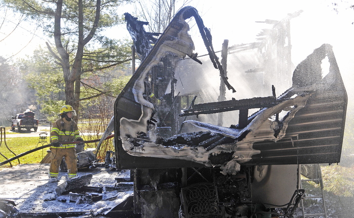 South China blaze: About 15 firefighters responded to a camper fire on Beach Road in South China on Tuesday morning. Laura Ellis escaped injury after her car caught fire and spread to the trailer she was staying in.