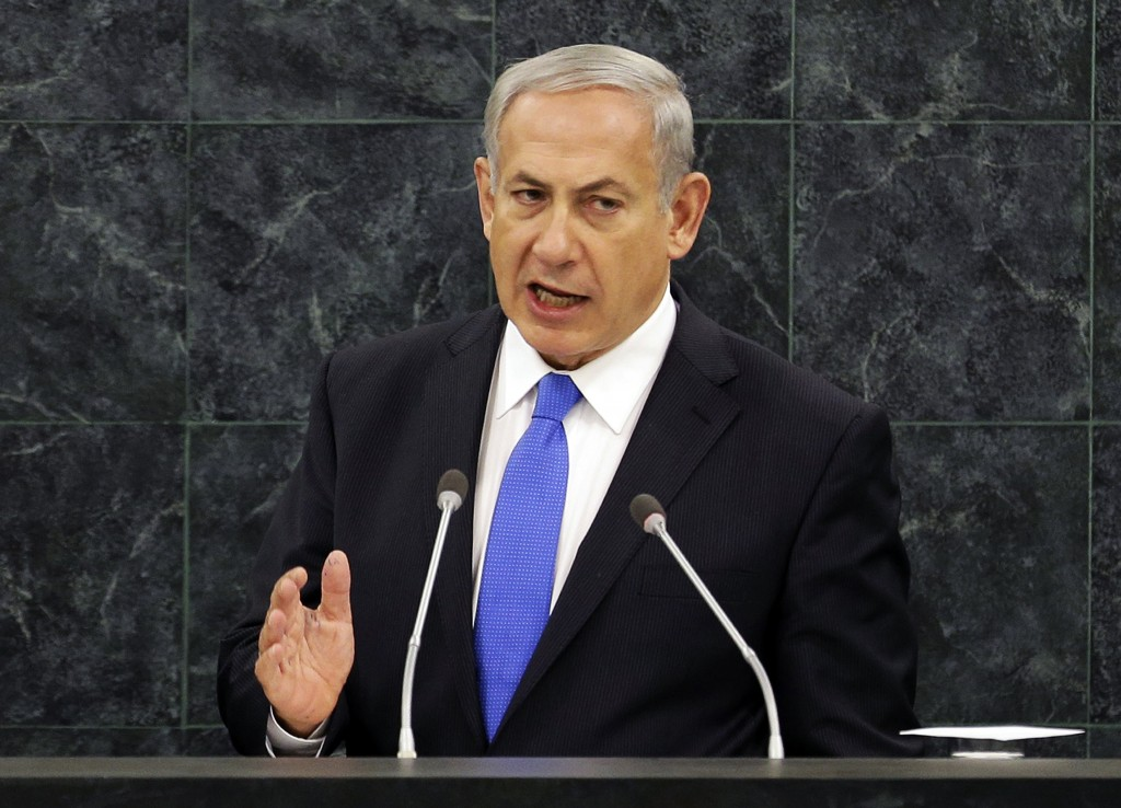 "FILE - In this Oct. 1, 2013, file photo, Israeli Prime Minister Benjamin Netanyahu speaks during the 68th session of the General Assembly at United Nations headquarters. The U.S. and Iran secretly engaged in high-level, face-to-face talks, at least three times over the past year, in a high stakes diplomatic gamble by the administration that paved the way for the historic deal aimed at slowing Iran's nuclear program. After a Sept. 27, phone call between President Barack Obama and Iranian president Hassan Rouhani, the U.S. began informing allies about the talks. Obama handled the most sensitive conversation himself, briefing Netanyahu during his Sept. 30 visit to the White House. The next day, in this speech to the U.N., Netanyahu blasted Rouhani as a""wolf in sheep's clothing."" (AP Photo/Seth Wenig, File)"