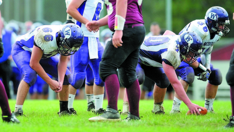 LEADING THE WAY: The Waterville Senior High School offensive line from left to right, Alex Danner (66) Ben Cox (70) and Luke Knight (56) will lead the Panthers into the Eastern C regional final, where they will face rival Winslow on Saturday.