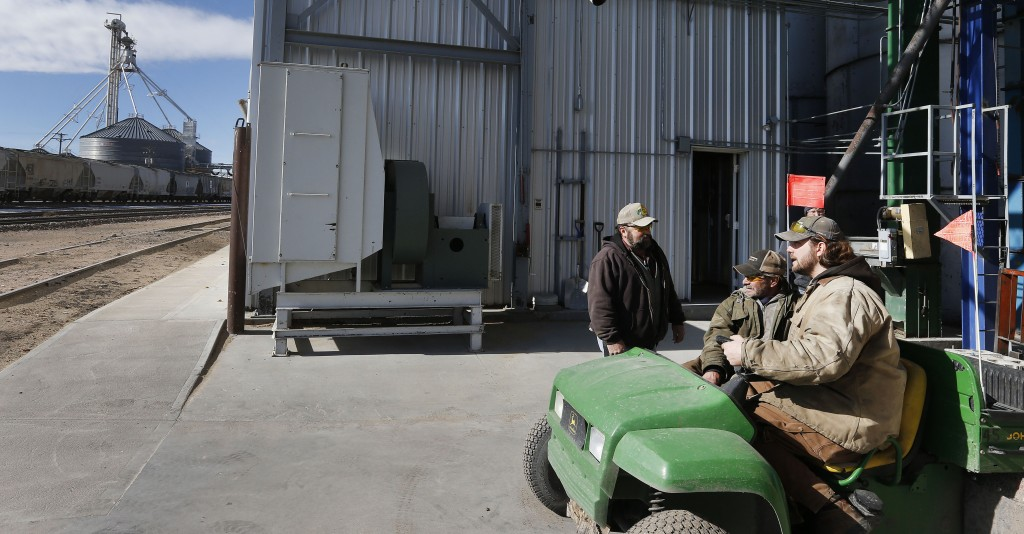 Workers, left to right, Dan Dannar, Jeff Brown and Kevin Orr talk at Global Harvest Foods, which produces birdseed and other grains in the rural town of Akron, the county seat of Washington County, Colo. A day earlier, a majority in Washington and four other counties on Colorado's Eastern Plains voted yes on the creation of a 51st state.