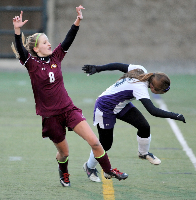 GOAL: Cape Elizabeth's Katherine Breed, left, celebrates her first half goal as Waterville Senior High School's Jayme Saulter tries to defend in the Class B state championship game Saturday at Hampden Academy.