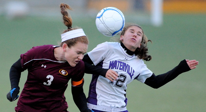 HEADS UP: Waterville Senior High School's Lydia Roy, right, battles for the ball with Cape Elizabeth's Elizabeth Raftice in the first half in the Class B State championship game at Hampden Academy on Saturday. Cape Elizabeth defeated Waterville in a shoot-out.