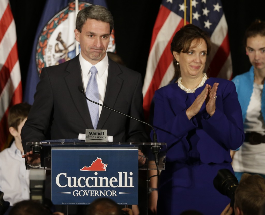 Republican gubernatorial candidate, Virginia Attorney General Ken Cuccinelli delivers his concession speech with his wife, Teiro, during a rally in Richmond, Va., Tuesday, Nov. 5, 2013. Cuccinelli was defeated by Democrat Terry McAuliffe.