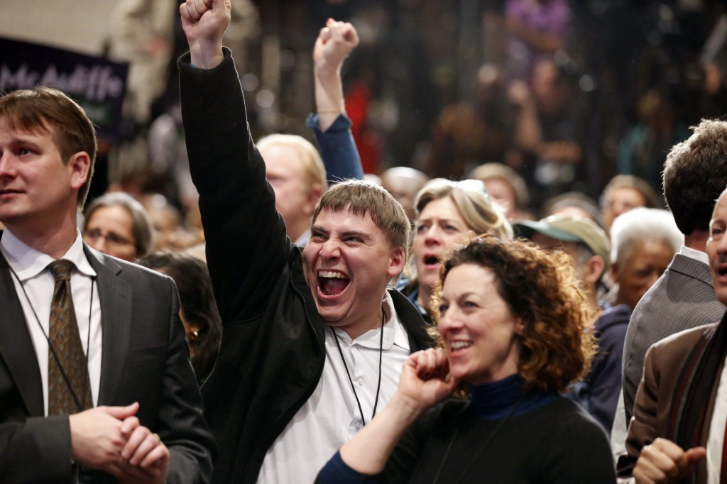 Supporters cheer as they watch the results on television at the election night party for Democratic gubernatorial candidate Terry McAuliffe, Tuesday, Nov. 5, 2013, in Tysons Corner, Va.