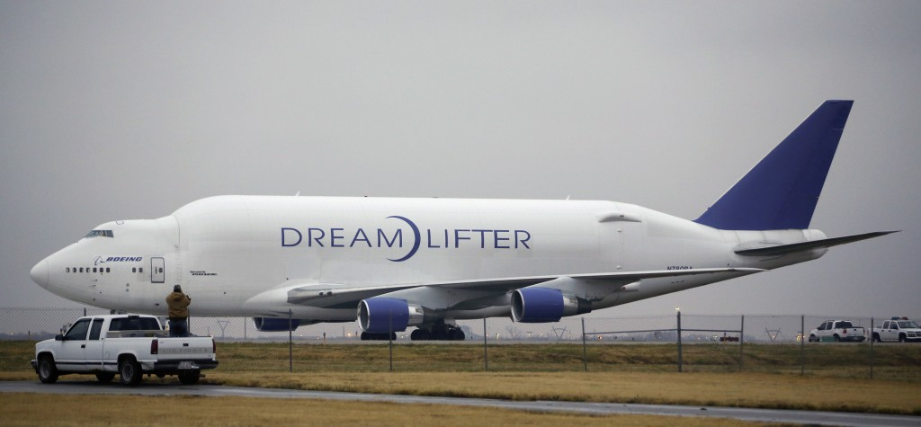 A man takes a photo of the Boeing 747 LCF Dreamlifter from the back of his truck Thursday, after the aircraft accidentally landed at Col. James Jabara Airport in Wichita, Kan. Wednesday night. Boeing says the Dreamlifter, a 747 jumbo jet used to haul parts for construction of its new 787 Dreamliner, landed safely at Jabara, about nine miles from McConnell Air Force Base in Wichita where it was supposed to land.