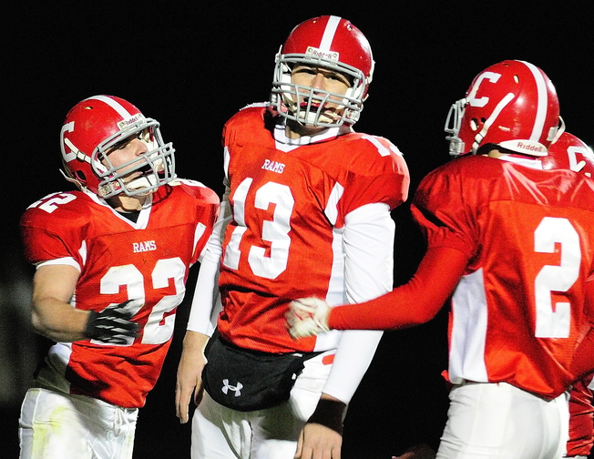 ONE MORE STEP: Cony quarterback Ben Lucas, center, is congratulated by teammates John Bennett, left, and Mitchell Bonnefant after scoring a touchdown in a game earlier this season. Lucas and the Rams will face Kennebunk in the Class B state championship game tonight at the University of Maine in Orono.