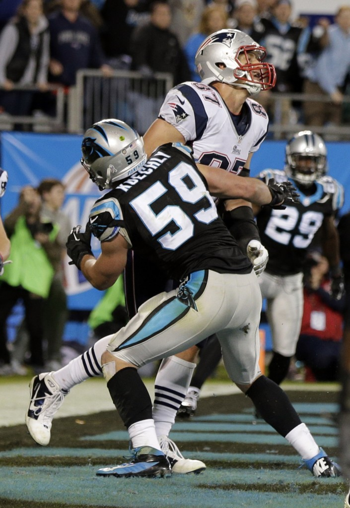 THE PLAY: Carolina's Luke Kuechly (59) hits New England's Rob Gronkowski (87) on the final play of the Patriots' 24-20 loss to the Panthers on Monday in Charlotte, N.C.