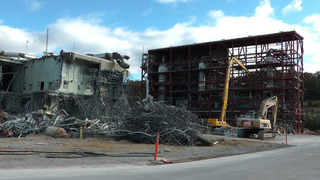 In this photo taken Tuesday, Nov. 12, 2013, workers continue the process of demolishing chemical waste incinerator at the Anniston Army Depot in Anniston, Ala. The Pentagon spent $10.2 billion over three decades burning chemical weapons stored in four states. Now, with those chemicals up in smoke and communities freed of a threat, the Armyís in the middle of another, $1.3 billion project: Demolishing the incinerators that destroyed the toxic materials.