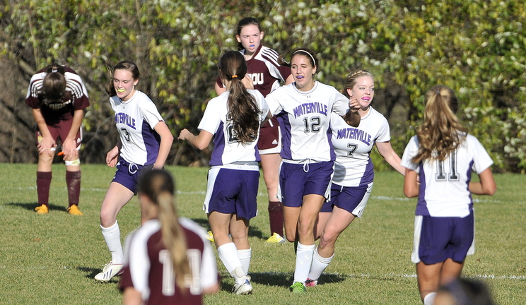CELEBRATE: Waterville Senior High School celebrates a second half goal against Caribou High School during the Panthers' 6-0 win in the Eastern B semifinals Saturday in Waterville.