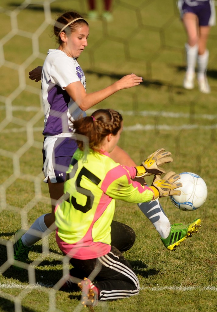 GOAL: Waterville Senior High School's Lydia Roy scores a goal against on Caribou High School goalie Morgan Outing during the Panthers' 6-0 win in the Eastern B semifinals Saturday in Waterville.
