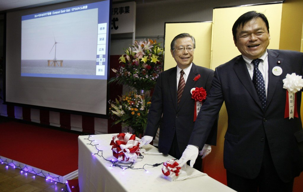 Japan's State Minister of Economy, Trade and Industry Kazuyoshi Akaba, right, and Fukushima Gov. Yuhei Sato push the start button during the launch ceremony of Fukushima Floating Offshore Wind Farm Demonstration Project in Iwaki, Fukushima Prefecture, northeastern Japan, Monday, Nov. 11, 2013. Japan switched on the first turbine at a wind farm 20 kilometers (12 miles) off the coast of Fukushima on Monday, feeding electricity to the grid tethered to the tsunami-crippled nuclear plant onshore. The wind farm near the Fukushima Dai-Ichi nuclear power plant is to eventually have a generation capacity of 1 gigawatt from 143 turbines, though its significance is not limited to the energy it will produce. (AP Photo/Koji Sasahara)