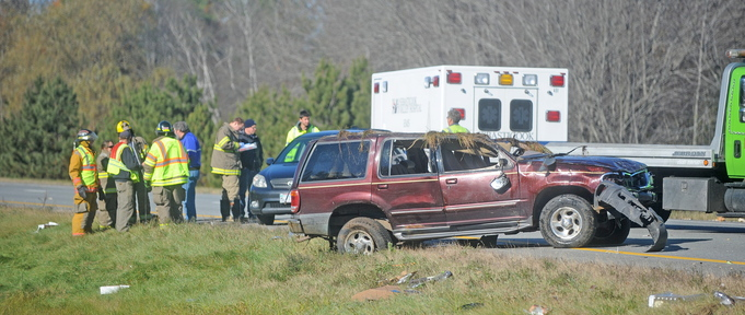 Crash scene: Rescue officials gather at the scene of a multi-car accident in Palmyra on the southbound section of Interstate 95 on Monday.