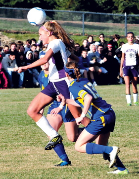 HEADS UP: Waterville's Colleen O'Donnell heads the ball away from Hermon's Maddie Page, right, during the Panthers' 2-1 win over Hermon in the Eastern B final Wednesday in Waterville.
