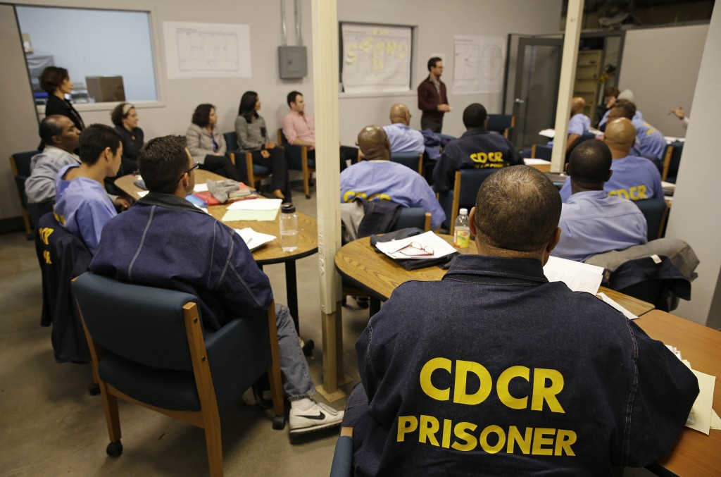 Inmates listen as Andrew Kaplan, a product marketing manager at Linkedin, leads a session of The Last Mile at San Quentin State Prison recently. The Last Mile program trains selected prisoners for eventual employment in a paid internship program within the Silicon Valley technology sector.