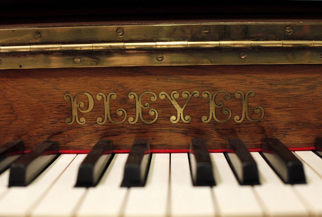 A Pleyel piano is displayed in a piano store, in Paris, Saturday, Nov. 16, 2013. Gone are its glory days, when Chopin composed concertos on its pianos. Franceís Pleyel piano maker is shutting its doors, unable to keep up with cheaper and more agile competition.