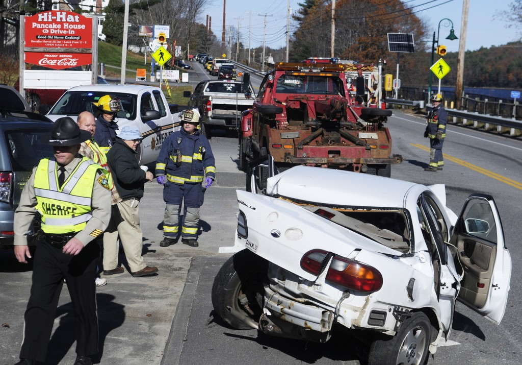 Staff photo by Andy Molloy TIE UP: Three people were injured Sunday morning just after 10 a.m. on U.S. Route 201 in Farmingdale following a three car collision, according to police. A southbound Jeep crossed the center line, striking a northbound Subaru station wagon that was pushed into a Chevy Malibu, according to Kennebec County Deputy Sheriff Galen Estes. Patients were taken to MaineGeneral in Augusta and Central Maine Medical Center in Lewiston, firefighters said. The accident that reduced traffic to a single lane for more than an hour remains under investigation, Estes said.