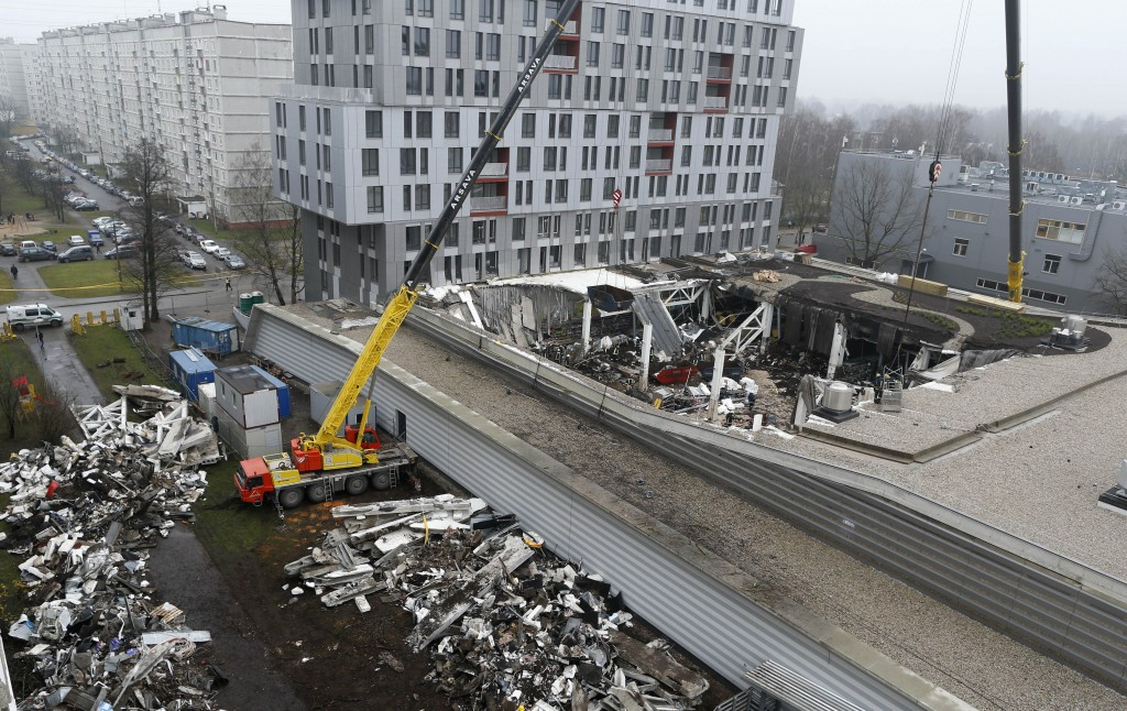 A view of collapsed Maxima supermarket in Riga, Latvia on Saturday. The roof fell Thursday evening in the Latvian capital of Riga as customers were doing after-work shopping.