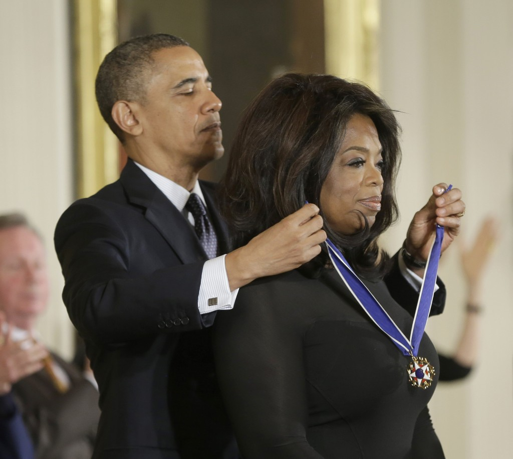 President Barack Obama awards Oprah Winfrey the Presidential Medal of Freedom.