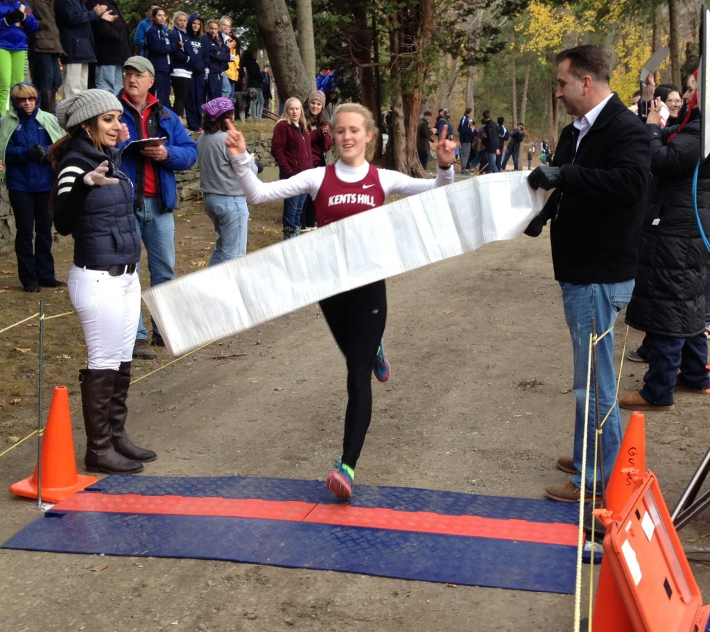 WINNING THE RACE: Kents Hill sophomore Anne McKee cross the finish line to win the Division 4 New England prep school cross country meet recently in Thompson, Conn.