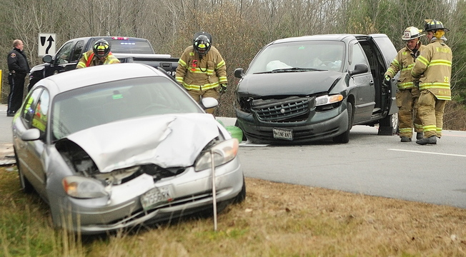 Winthrop emergency crews work at the scene of a two-vehicle collision on Tuesday November 19, 2013 at the corner of Pineland Lane and Route 202 in Winthrop.