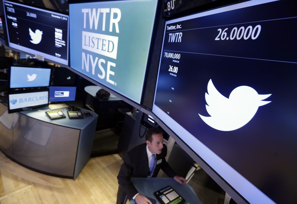 Specialist Glenn Carell, who handled the Twitter IPO, works at his post on the floor of the New York Stock Exchange on Thursday.