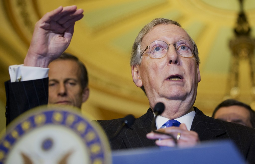 Senate Minority Leader Mitch McConnell of Ky. gestures during a news conference on Capitol Hill in Washington, Tuesday, Nov. 19, 2013.