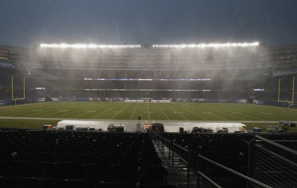 Heavy rain falls as play is suspended during the first half of the Bears-Ravens football game Sunday in Chicago.
