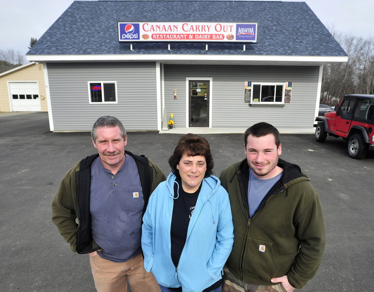 CANAAN CARRY OUT: Tim and Jane LaPlant, and their son T.J. stand in front of their new business Canaan Carry Out on Main Street in Canaan on Friday. The LaPlants are happy with the proposed $3 million-plus U.S. Route 2 state road improvement project.