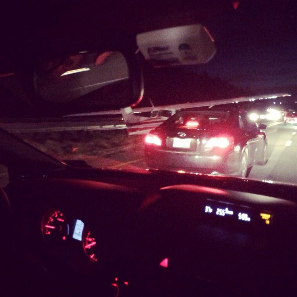 A commuter took this photo from his vehicle on Interstate 295 showing a plane at left after it made an emergency landing on the highway Thursday evening.
