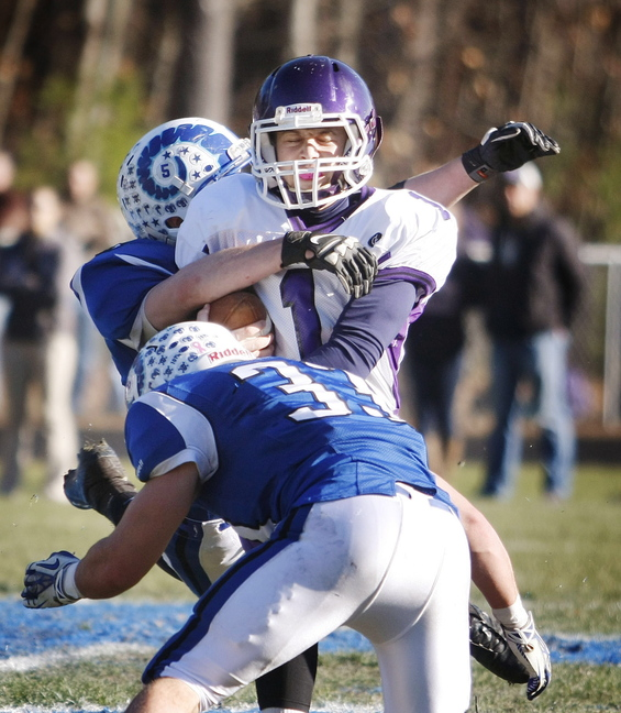 Marshwood #1 Luc Blanchette is surrounded by Kennebunk defenders #3 Chris Broadhead and #33 Nicco DeLorenzo during first half action in the Western Class B regional final at Kennebunk High School Saturday, Nov. 16, 2013. Jill Brady/Staff Photographer.
