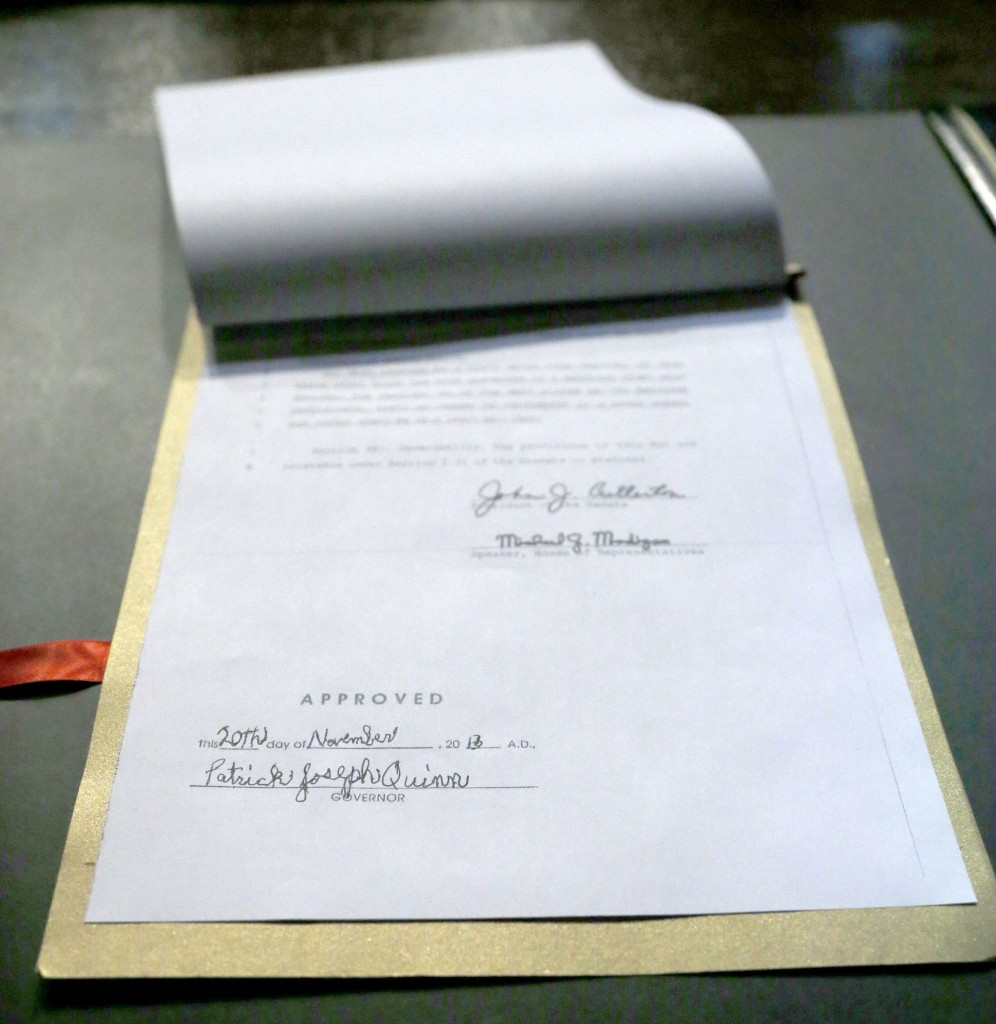 The signature of Illinois Gov. Patrick Joseph Quinn is affixed to the Religious Freedom and Marriage Fairness Act into law during ceremonies on the campus of the University of Illinois Chicago Wednesday, Nov. 20, 2013, in Chicago. Illinois becomes the 16th state to legalize same-sex marriage.
