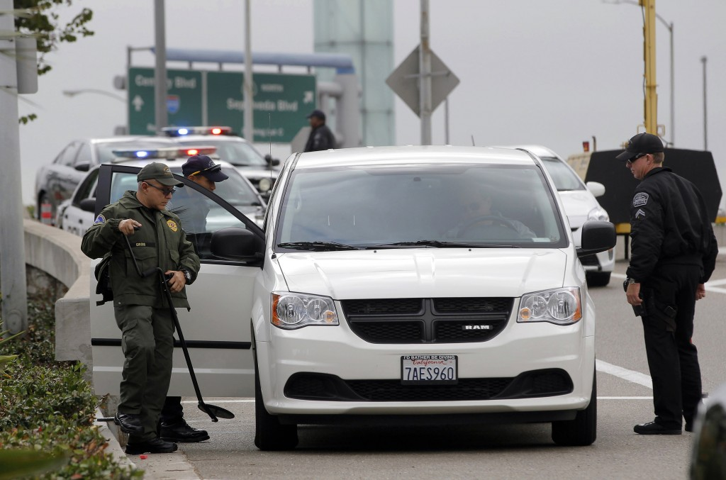 Security officers check a vehicle at a perimeter access road to Los Angeles International Airport on Monday. Operations at the airport were back to normal Monday, the first business day since a gunman killed a TSA agent there.