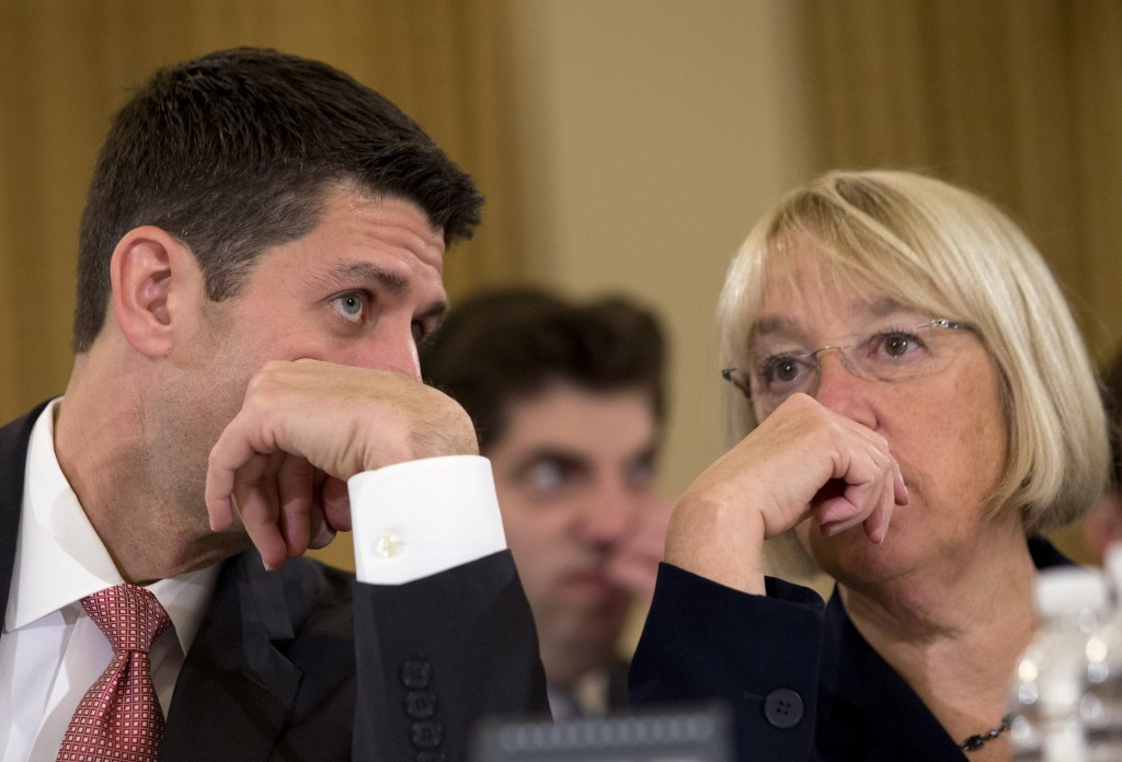 """House Budget Committee Chairman Rep. Paul Ryan, R-Wis., speaks with Senate Budget Committee Chair Sen. Patty Murray, D-Wash., Wednesday at the start of a Congressional Budget Conference. Budget negotiators heard testimony from CBO Director Douglas Elmendorf who urged """"big steps"""" toward an agreement."""