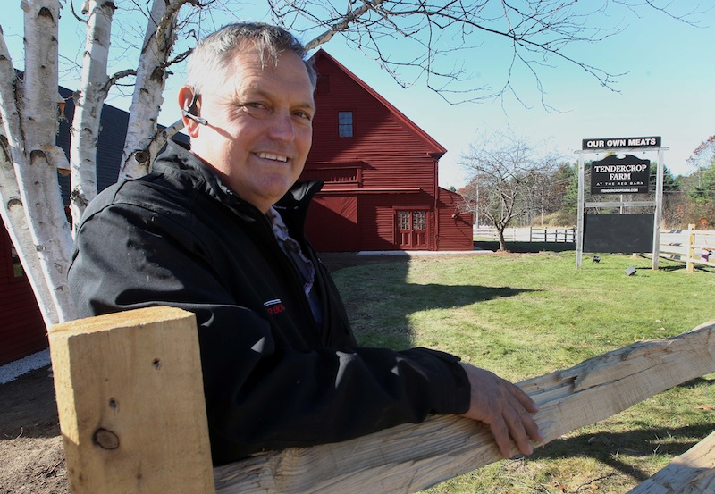Matt Kozazcki poses in front of the old red barn at the former Tuttle Farm in Dover, N.H., on Tuesday Nov. 5, 2013. Kozazcki recently purchased the 135-acre farm from the Tuttle family. The farm, one of America's oldest continuously operated family farms, began in 1632 when John Tuttle arrived from England, using a small land grant from King Charles I to start his enterprise.