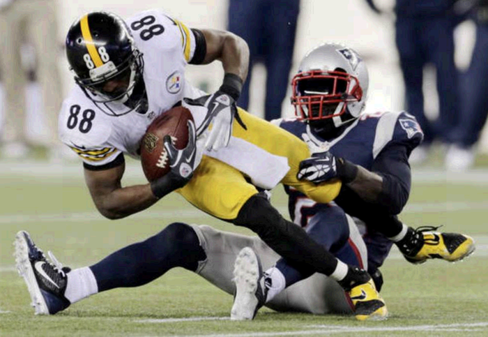 New England Patriots cornerback Kyle Arrington, right, tackles Pittsburgh Steelers wide receiver Emmanuel Sanders in the fourth quarter of Sunday's game in Foxborough, Mass. The Patriots won 55-31.