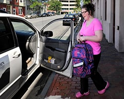 Rebecca Lee gets a ride home last summer from the Goodwill Neurorehab Services in Portland, which happened to be working nearby that day, after her schedule MaineCare ride failed to show up. State officials say they are still evaluating the performance of a Connecticut company that has mishandled medical transportation arrangements for thousands of MaineCare patients since it started working for the state four months ago.