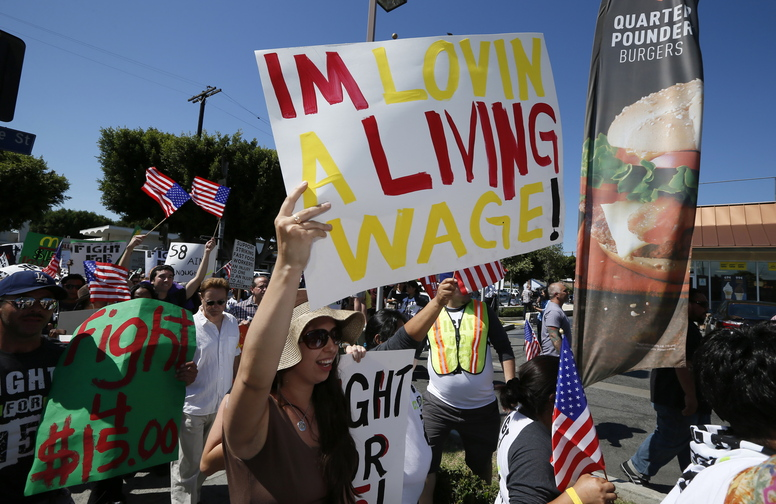 Workers and their supporters protest outside McDonald's in Los Angeles as part of a nationwide strike by fast-food workers in August to call for wages of $15 an hour.