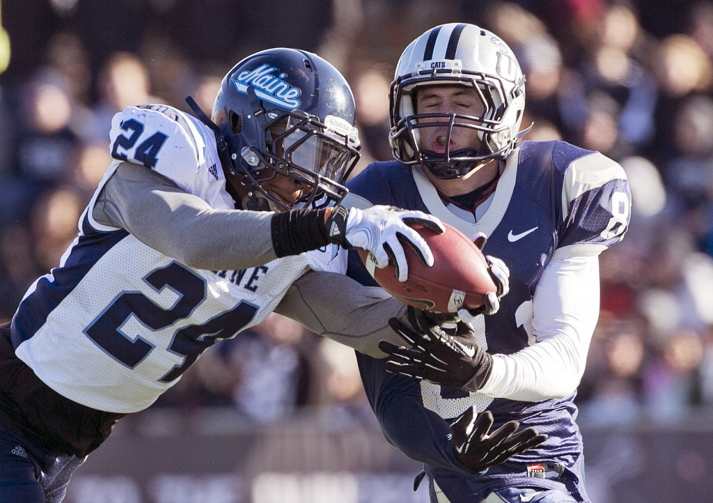 Maine defensive back Khari Al-Mateen (24) breaks up a pass intended for New Hampshire wide receiver Jared Allison (8) in the first half of an NCAA college football game Saturday, Nov. 23, 2013, in Durham, N.H. (AP Photo/Robert F. Bukaty)