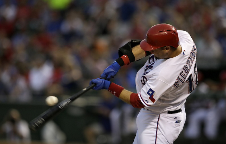 Rangers' A.J. Pierzynski swings at a pitch in the first inning against the Oakland A's, in Arlington, Texas, on Sept. 13. A person with knowledge of the negotiations says free-agent catcher Pierzynski is closing in on a one-year contract with the Boston Red Sox.