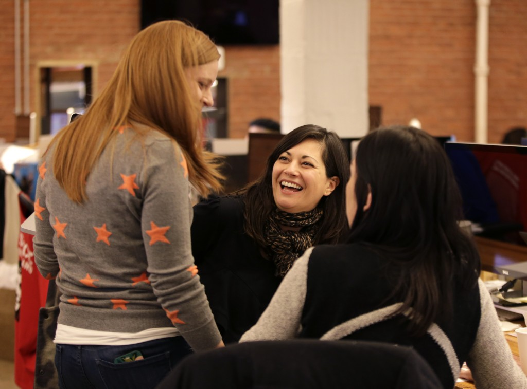 "Shirin Majid, center, talks to co-workers at Quirky headquarters in New York recently. Majid, a new mother, recently took advantage of the company's ""blackout week"" policy in which employees may take off one week a quarter. Company founder and CEO Ben Kaufman instituted the policy to experiment with ways for people to work smarter and to prevent burnout."