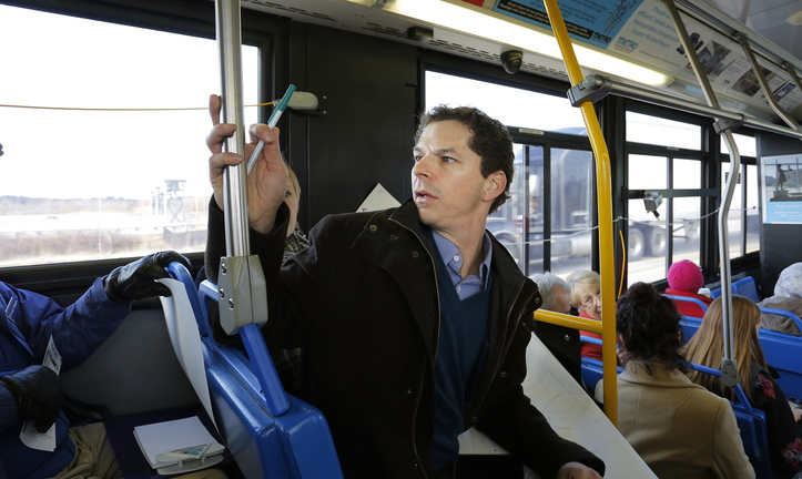 Maine Senate President Justin Alfond rode bus No. 5 on Portland's Metro system Tuesday along with other politicians and protesters to see how long the bus ride would be from Portland to the proposed site of the DHHS offices in South Portland.