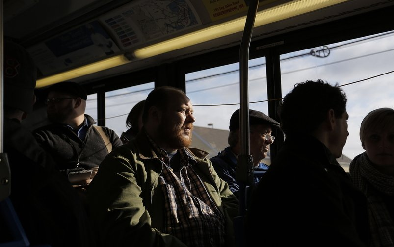 Thomas Ptacek of Homeless Voices for Justice and state Rep. Dick Farnsworth ride the No. 5 bus Tuesday as part of a protest.