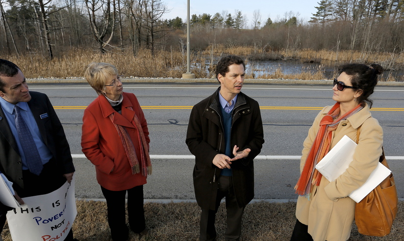 Maine Senate Ppresident Justin Alfond, center, addresses the media at the site of the proposed DHHS offices in South Portland. Alfond said he thinks the move is part of Gov. Paul LePage's plan to make it more difficult for poor people to get needed services.