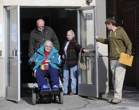 ON THE MOVE: Religious and union leaders from Kennebec County emerge Wednesday from a meeting with Stefanie Nadeau, of MaineCare Services, in Augusta to talk about the plight of their parishioners and members who have had trouble getting rides to their medical appointments.
