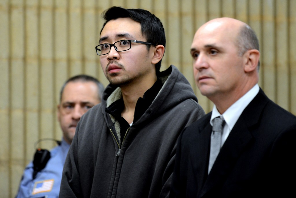 University of New Haven student William Dong, 22, of Fairfield, Conn., with assistant public defender Kevin Williams, right, appears during his arraingment Wednesday, Dec. 4, 2013, at Superior Court in Milford, Conn. Dong, 22, was charged with illegal possession of an assault weapon and other crimes after Tuesday's scare, which led to a a University of New Haven campus lockdown of more than four hours. Police say they don't know why Dong brought guns to the campus.