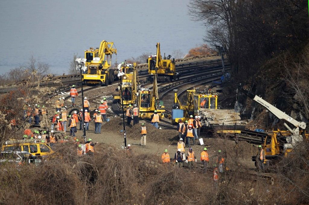 Repair work is underway at the site of a train derailment in the Bronx borough of New York, Tuesday, Dec. 3, 2013. The National Transportation Safety Board says right now, it doesn't know whether faulty brakes or human error caused Sunday's derailment of a New York City train that killed four people and injured more than 60. But NTSB member Earl Weener says information from the train's two data recorders shows the train was going 82 mph on a turn when it should have been going no more than 30 mph.