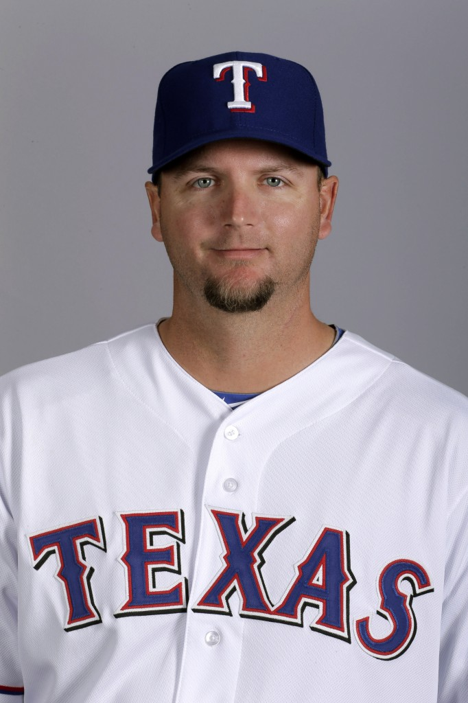 FILE - This 2013 file photo shows A.J. Pierzynski of the Texas Rangers baseball team. A person with knowledge of the negotiations says free-agent catcher Pierzynski is closing in on a one-year contract with the Boston Red Sox. The deal would be pending a physical. The person spoke on condition of anonymity Tuesday, Dec. 3, 2013, because the team hadn't finalized the agreement. (AP Photo/Charlie Riedel, File)