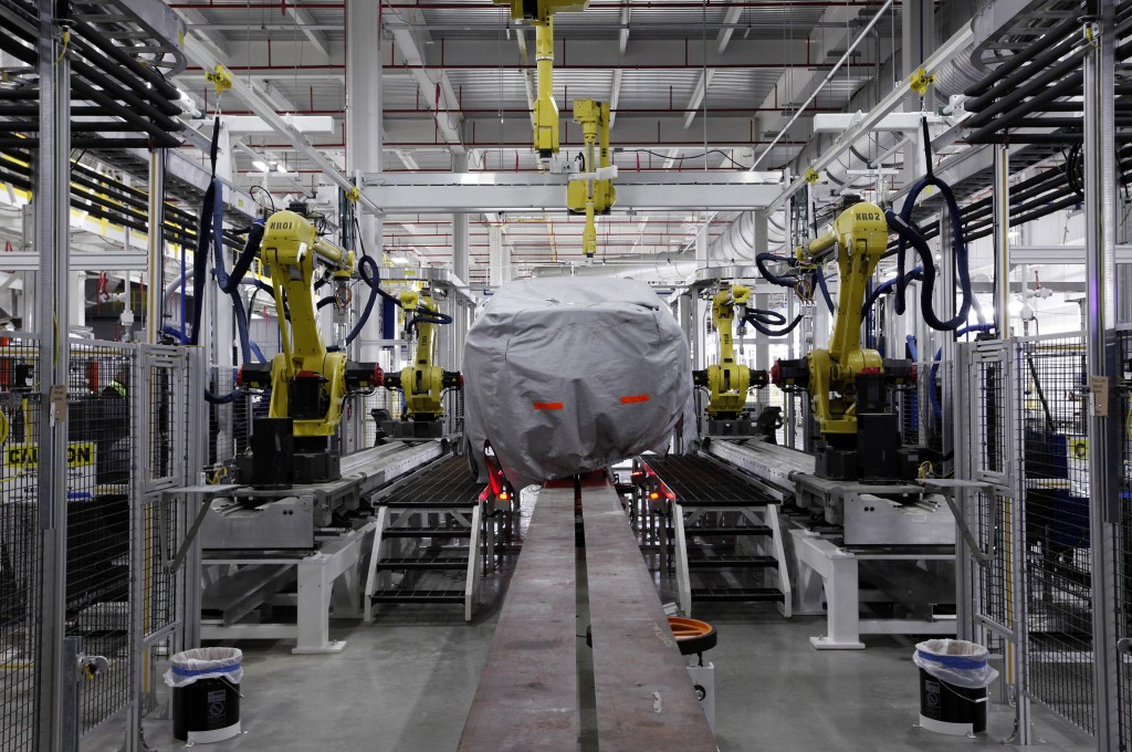 A covered vehicle sits in part of the new paint shop at Chrysler's Sterling Heights Assembly Plant in Sterling Heights, Mich. November car sales rose 9 percent and are running at an annual rate of 16.4 million, the best performance of the year, according to Autodata Corp.