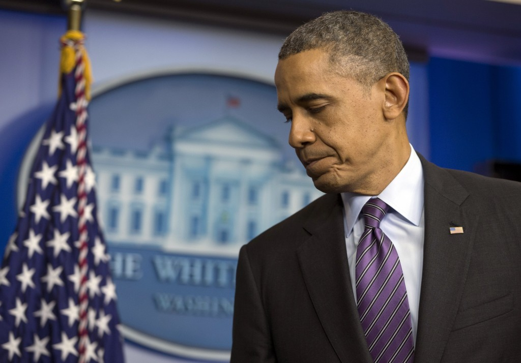 President Barack Obama turns from the podium after speaking in the briefing room of the White House in Washington, Thursday, Dec. 5, 2013, about the death of Nelson Mandela. Obama says the world has lost an influential, courageous and 'profoundly good' man with the death of anti-apartheid icon Mandela.